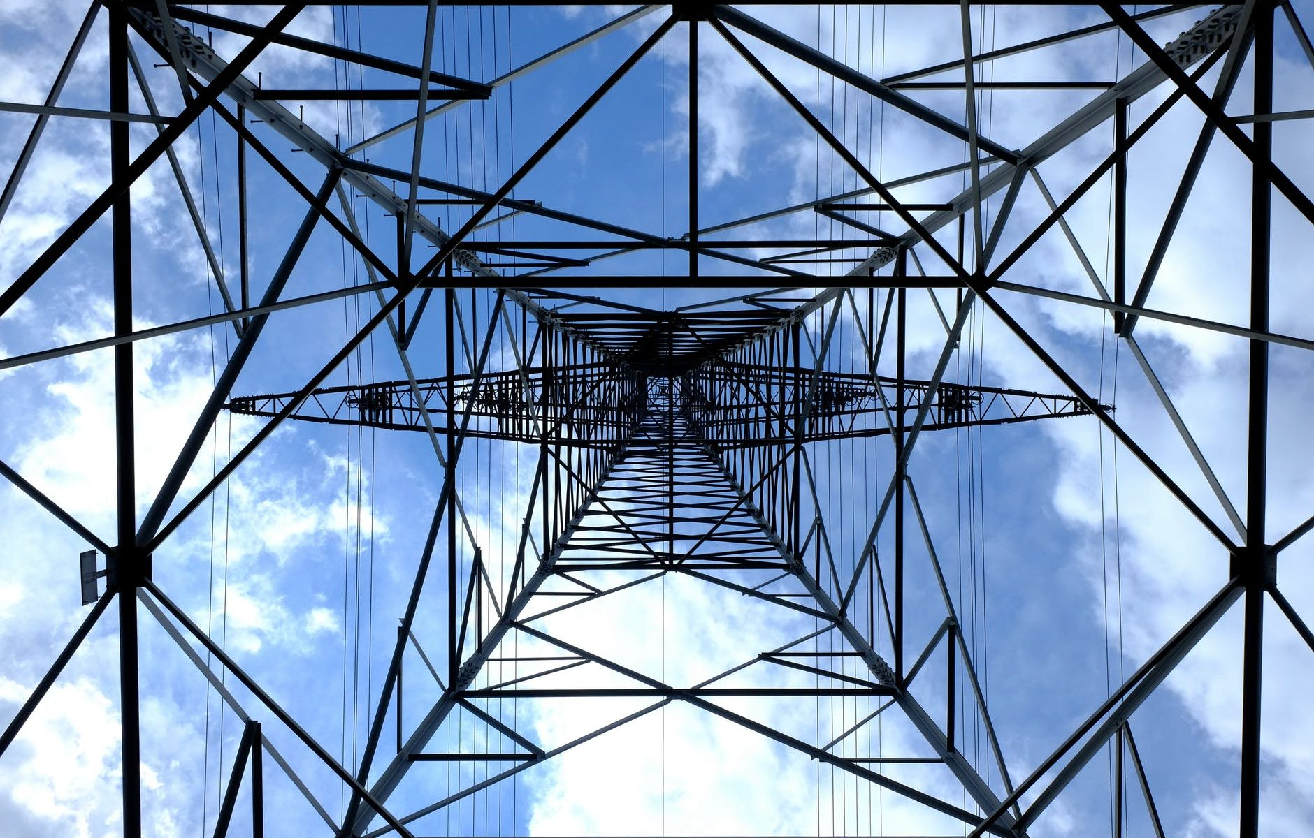 low angle photograph of black metal tower satellite during daytime